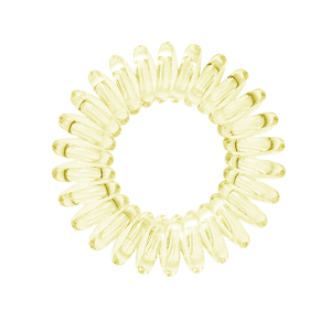 A light yellow coloured plastic spiral circular hair bobble on a white background called a spirabobble.