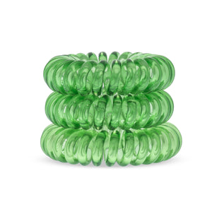 A tower of 3 lime time green coloured hair bobbles called spirabobbles. A green plastic spiral circular hair tie spira bobble.