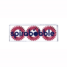 Load image into Gallery viewer, A flat transparent box of 3 maroon red coloured hair accessories called spirabobbles