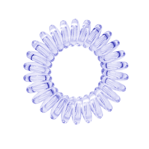 A navy blue clear coloured plastic circular hairband on a white background that looks like an old fashioned curly coiled telephone cable or a coiled spring which has been made into a circular shape
