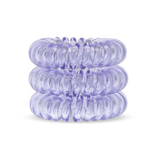 Load image into Gallery viewer, A tower of 3 pale purple coloured hair bobbles called spirabobbles. A plastic spiral circular hair tie spira bobble.