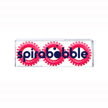 Load image into Gallery viewer, A flat transparent box of 3 perfect rose pink coloured hair accessories called spirabobbles