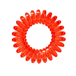 A red coloured plastic spiral circular hair bobble on a white background called a spirabobble.