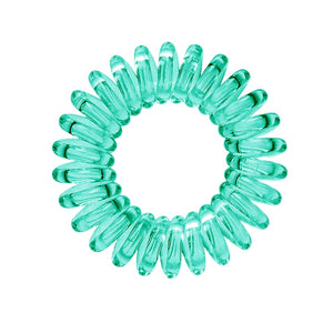A serene green coloured plastic spiral circular hair bobble on a white background called a spirabobble.