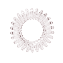 Load image into Gallery viewer, A see through clear coloured plastic circular hairband on a white background that looks like an old fashioned curly coiled telephone cable or a coiled spring which has been made into a circular shape
