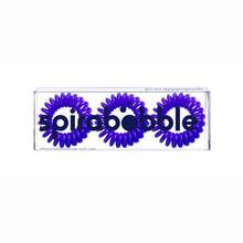 Load image into Gallery viewer, A flat transparent box of 3 purple coloured hair accessories called spirabobbles