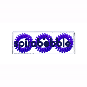 A flat transparent box of 3 purple coloured hair accessories called spirabobbles