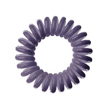 Load image into Gallery viewer, A dark grey solid coloured plastic circular hairband on a white background that looks like an old fashioned curly coiled telephone cable or a coiled spring which has been made into a circular shape