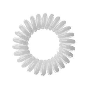 A pale grey coloured plastic spiral circular hair bobble on a white background called a spirabobble.