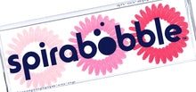 Load image into Gallery viewer, A flat transparent box of 3 pretty in pink coloured hair accessories called spirabobbles