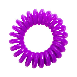 A purple berry coloured plastic spiral circular hair bobble on a white background called a spirabobble.