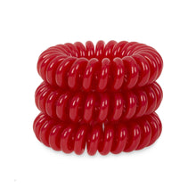 Load image into Gallery viewer, A tower of 3 red coloured hair bobbles called spirabobbles. A plastic spiral circular hair tie spira bobble.