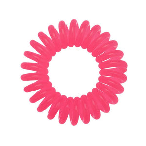 A rose pink coloured plastic spiral circular hair bobble on a white background called a spirabobble.