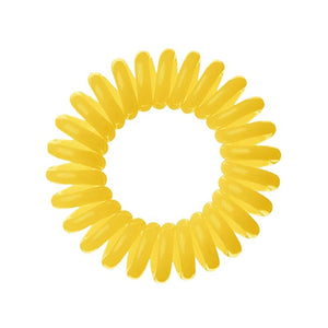 A yellow coloured plastic spiral circular hair bobble on a white background called a spirabobble.