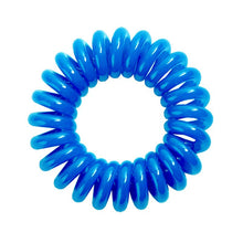 Load image into Gallery viewer, A turquoise blue solid coloured plastic circular hairband on a white background that looks like an old fashioned curly coiled telephone cable or a coiled spring which has been made into a circular shape