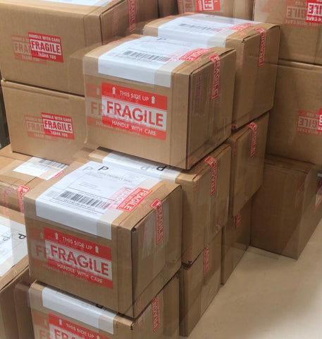 Blurred Shipping Boxes Stacked with Fragile Label