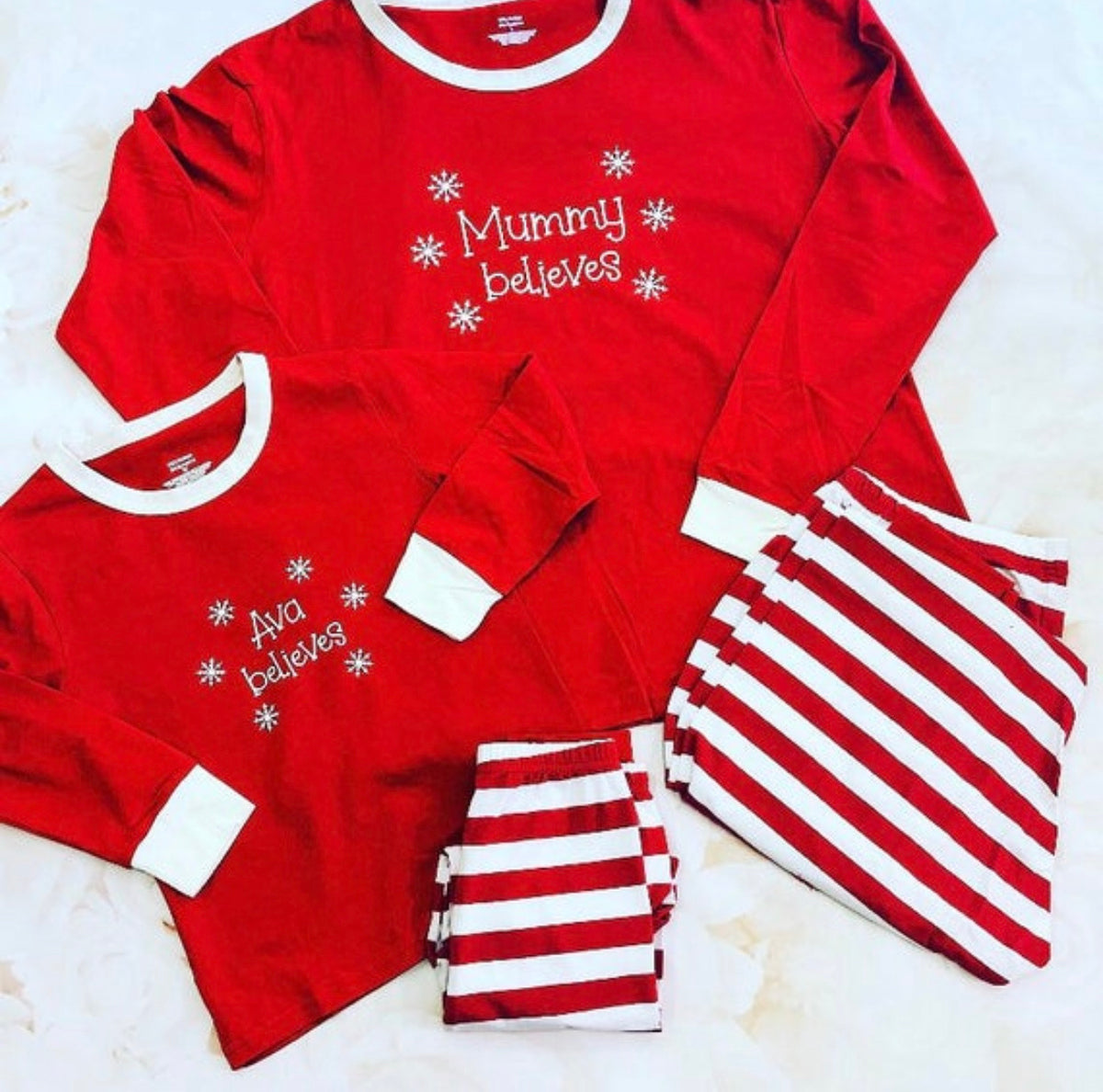 "Striped Christmas Family Pyjamas with ""name BELIEVES"" design"