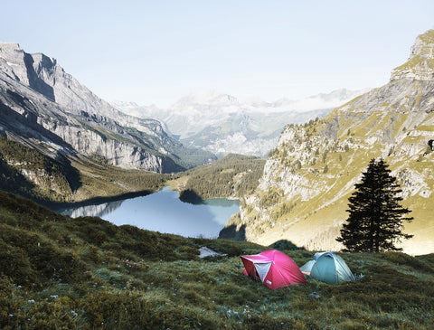 Tents on mountain overlooking lake