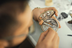 Watchmaker working on a watch in workshop