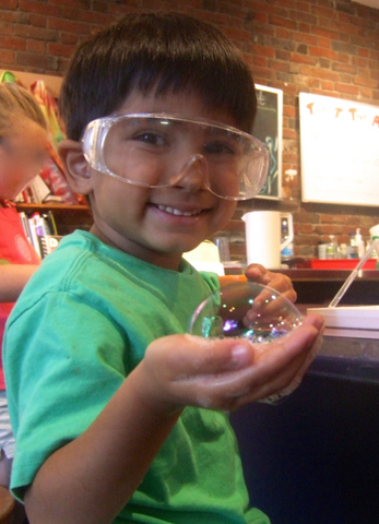 Sebastian at age 5 with a bubble he made at the Museum of Science, Boston
