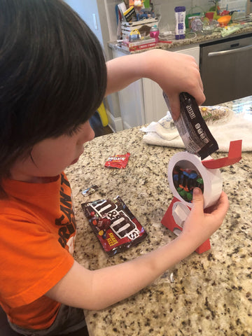 boy filling octogift dispenser