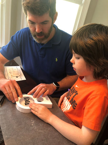 boy and dad building octogift
