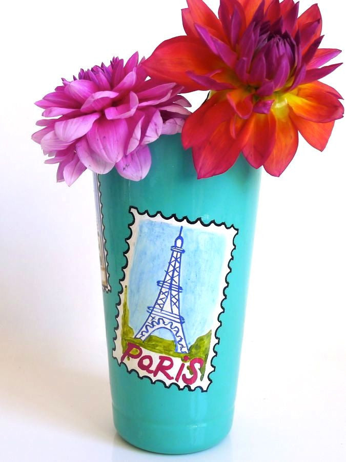 Turquoise vase with Paris landmark postcards