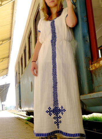 White traditional Ethiopian dress with blue cross embroidered motif