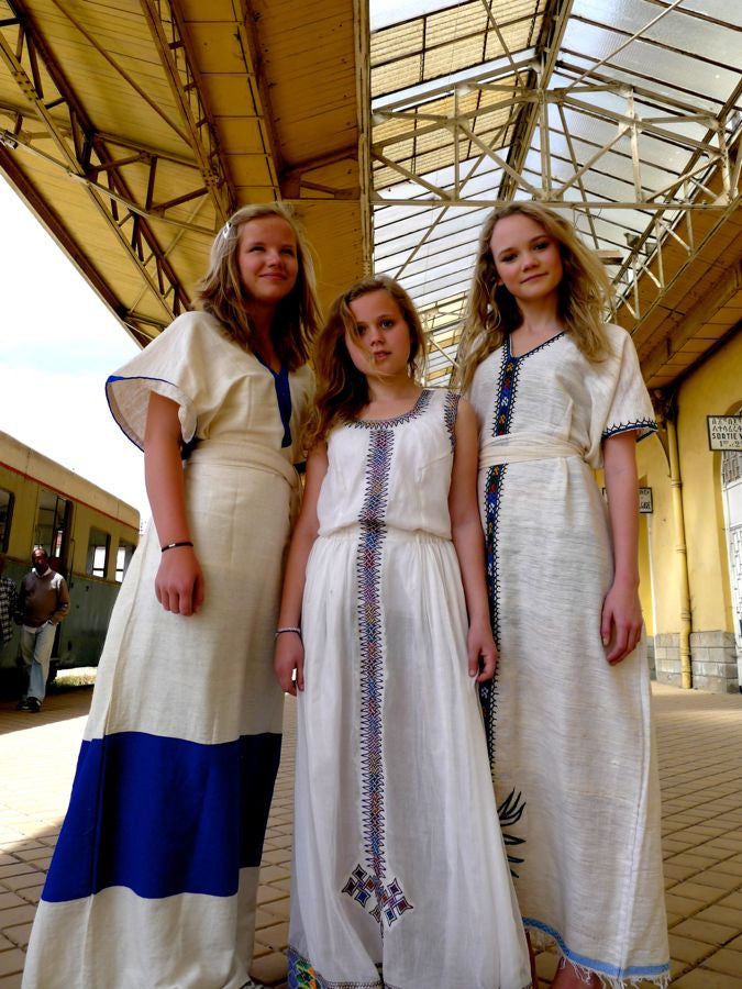 White traditional Ethiopian dress with blue / pink / green