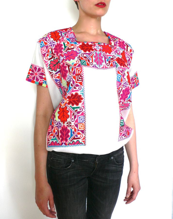Pink red and white cross-stitched blouses Mexico