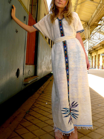 White traditional Ethiopian dress with multicolored embroidery