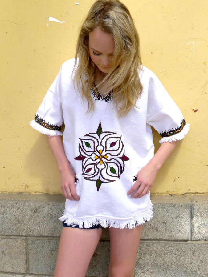 White traditional Ethiopian tunic with multicolored cross embroidered motif