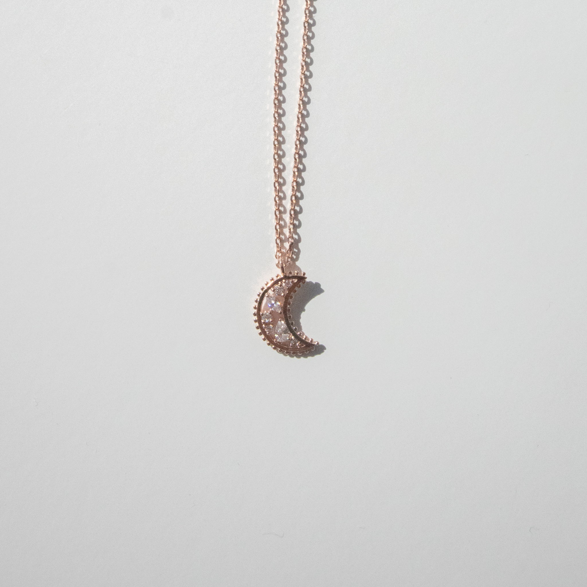 Rose Gold Dipped Jeweled Crescent Moon Necklace