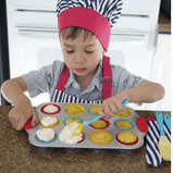 a kid playing with his Mini Cupcake Baking Set