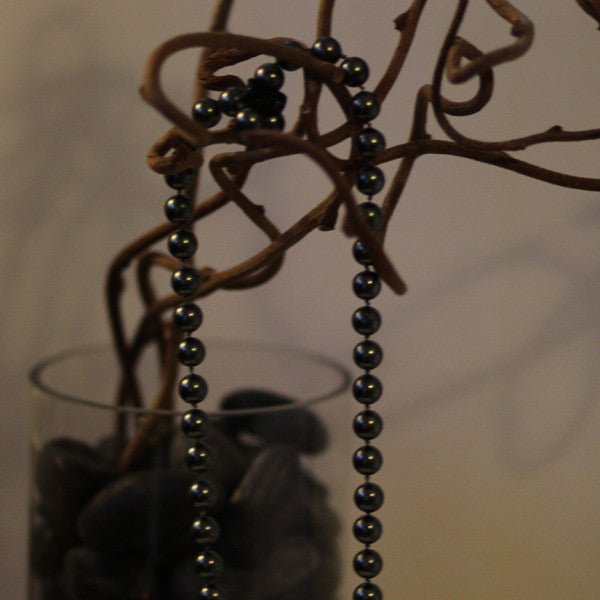 Beaded necklace with Tahitian pearls and a Love bullet pendant
