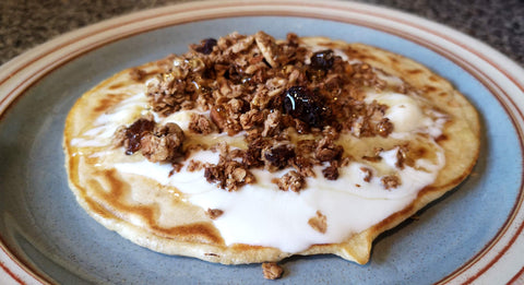 Homemade whey pancake ready to eat with granola