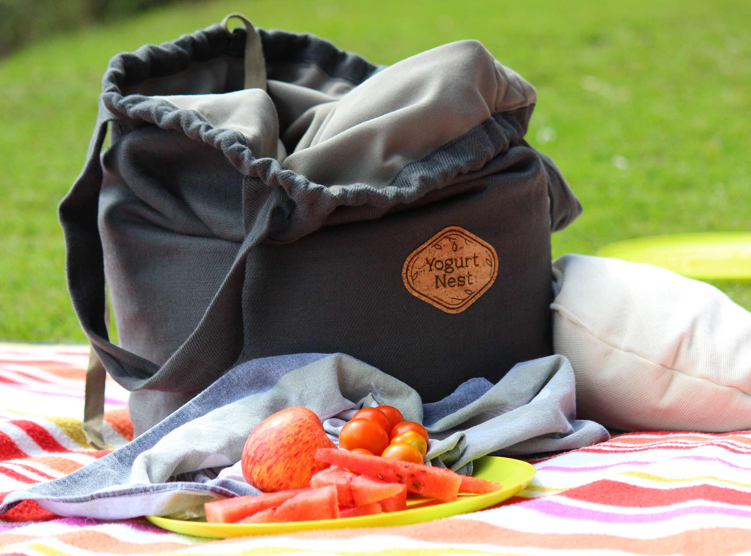 Lichen Traveller YogurtNest with handles and picnic by a river