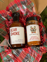 This is the perfect pair of Bear Smoke BBQ Cam Cam Chipotle BBQ Sauce and our Angry Bear Hot BBQ Rub for those who like their bbq nice and spicy. This is Campbell's (one of the mini bears) favorite combination and it is almost as sassy as the teenager she is.  Includes:  16 oz bottle of Recipe No. 2 - Cam Cam Chipotle BBQ Sauce  8 oz (net wt.) bottle of Rub No.2 - Angry Bear Hot BBQ