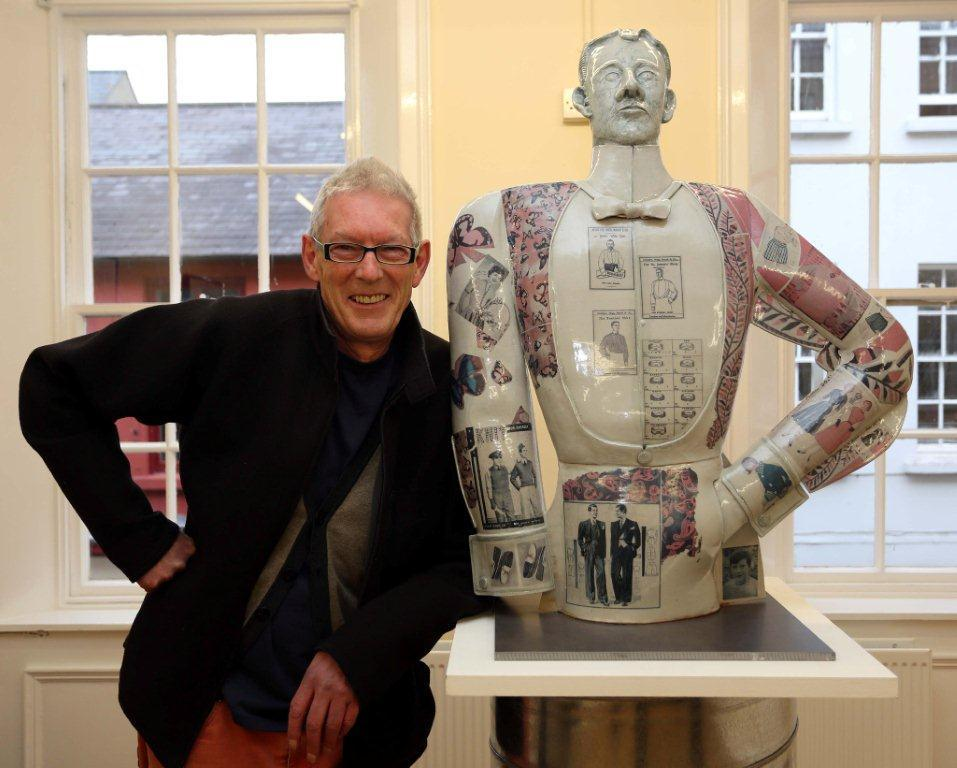 Tom Agnew and a large sculpture based on the shirt factories and resides in the Bishop's Gate Hotel, Derry.