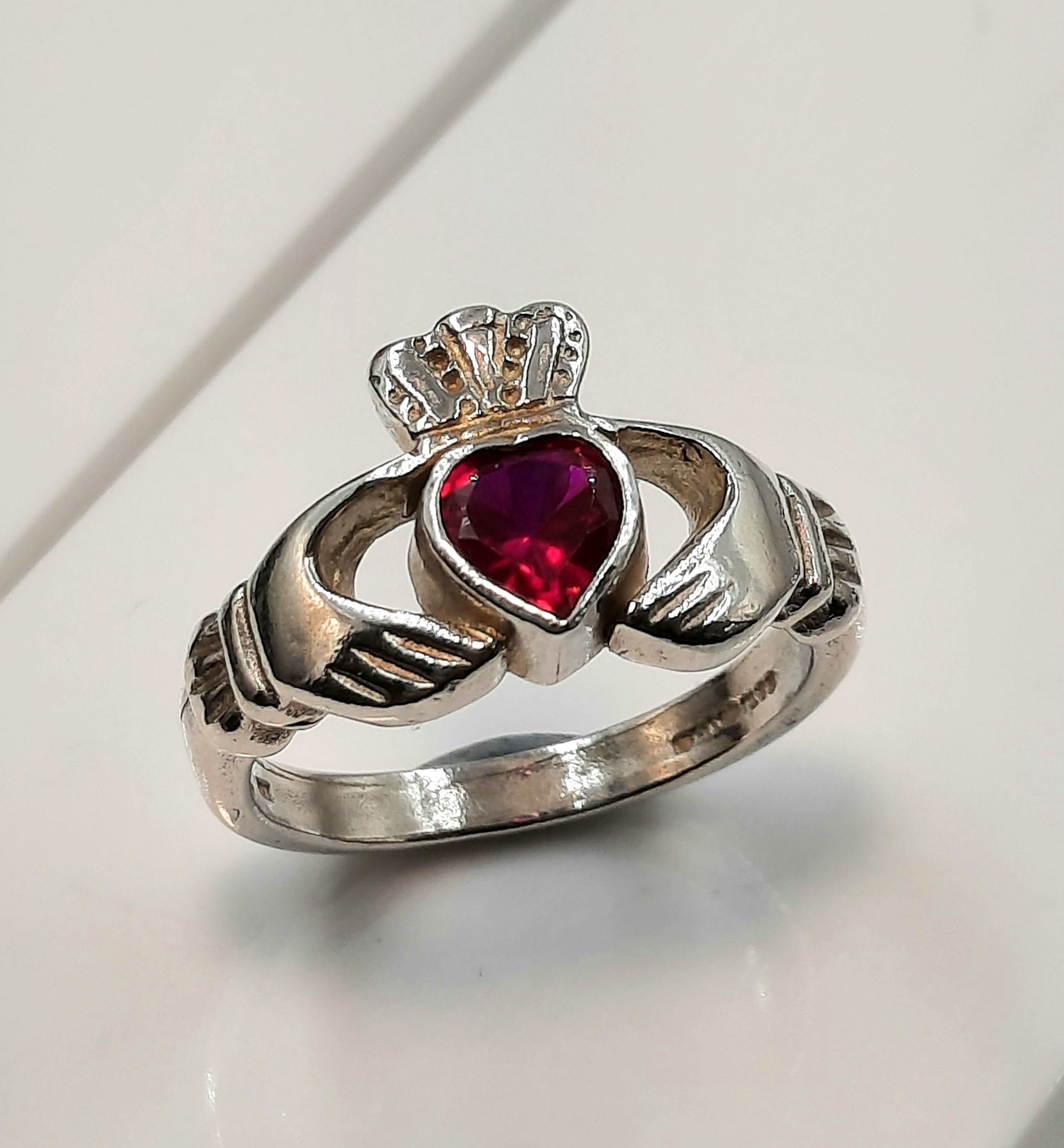 Ladies claddagh sterling silver ring with red stone