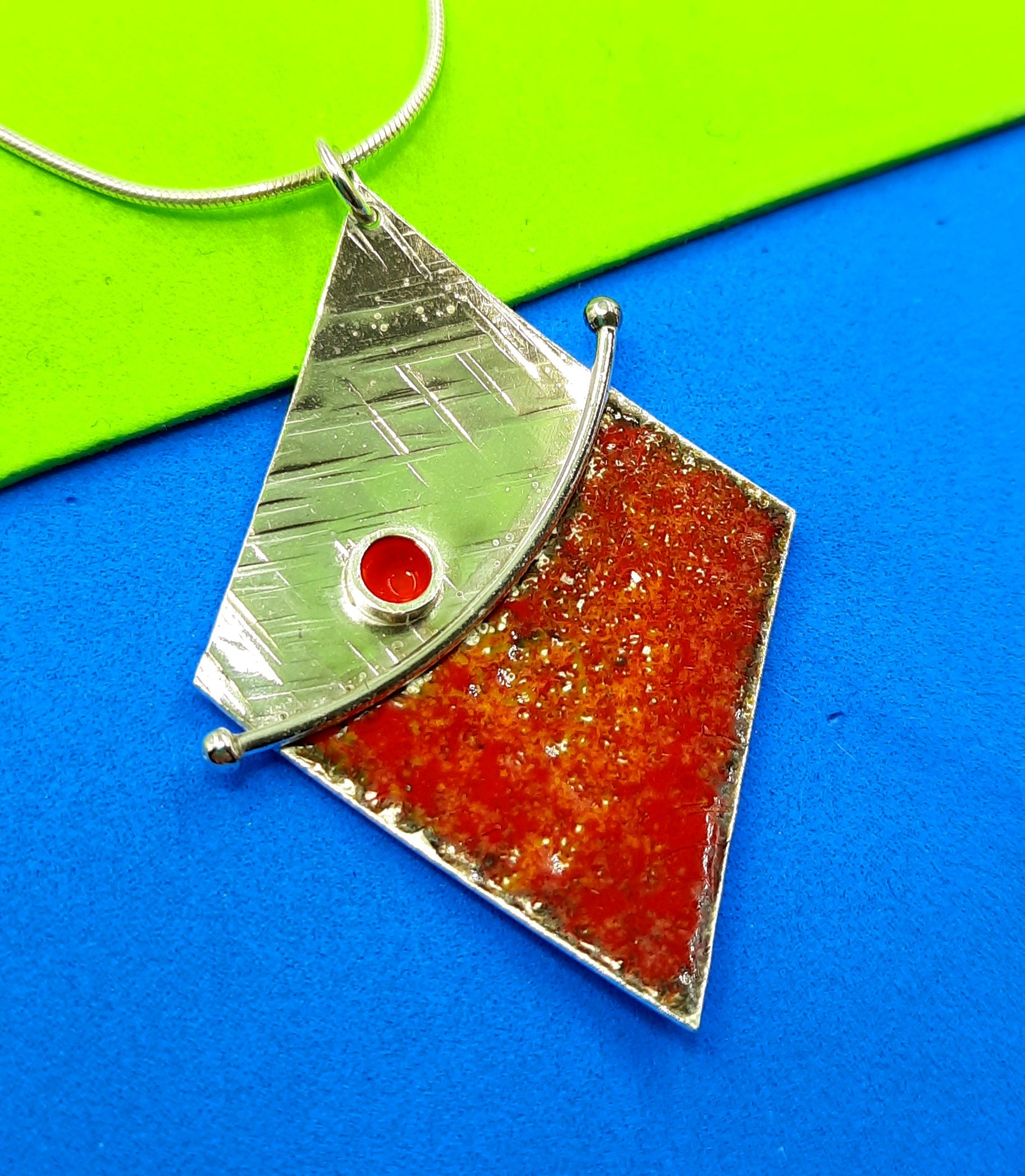 Diamond shaped enamelled sterling silver pendant