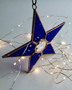 Stained glass star with clear faceted jewel centre