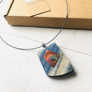 Blue coloured wooden pendant with heat coloured copper and neck wire.
