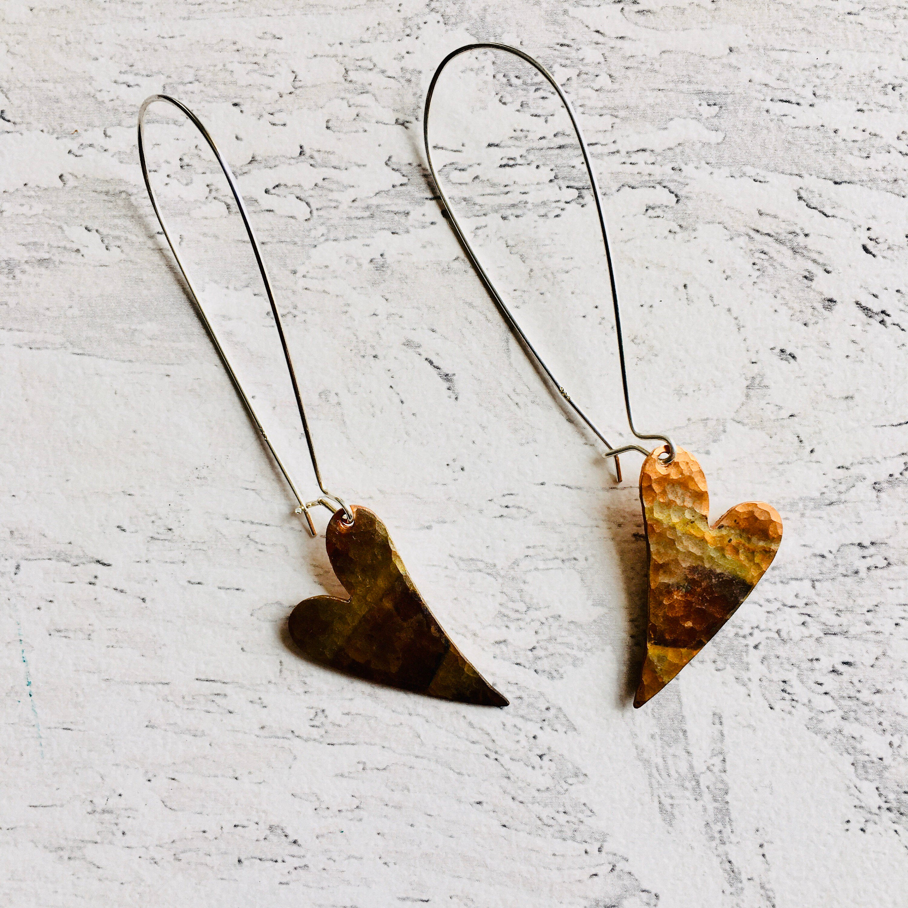 Heart Earrings with sterling silver ear findings. Each earring patinated using the flame of a torch.