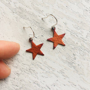 Star Earrings in red patinated copper, and, sterling silver ear findings.