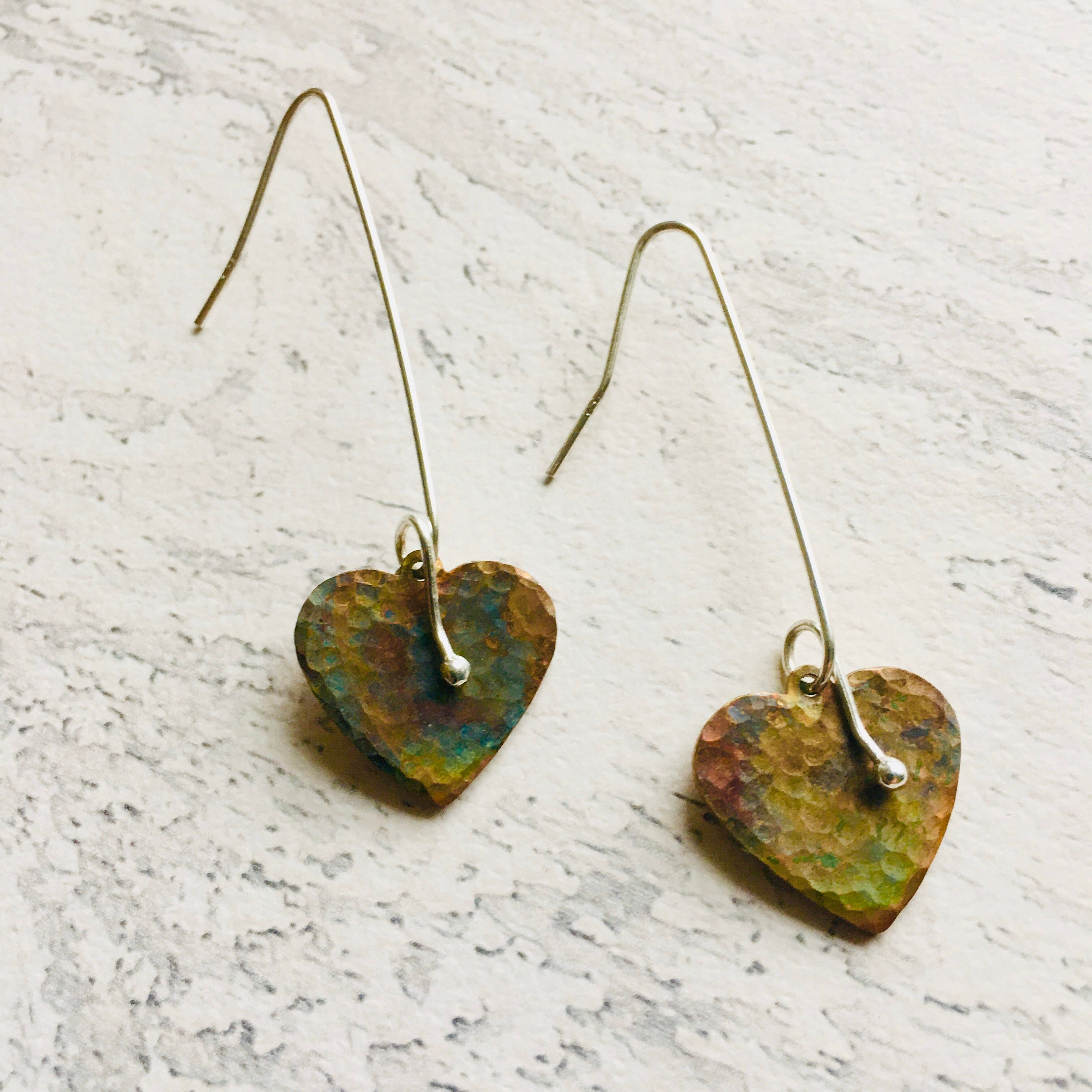 Heart Shaped Drop Eartings with sterliing silver ear wires. Rainbow coloured copper created with heat treatment.