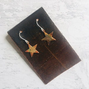 Star Earrings, heat patinated copper with rainbow colours. Easily worn with silver ear findings.