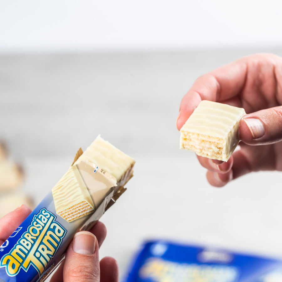 Tirma White Chocolate Wafers unwrapped and broken in half to display the wafer which is cream filled inside covered in white chocolate.