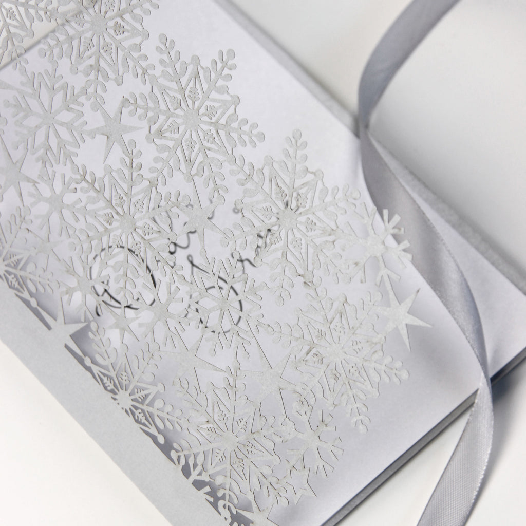 White Winter, a Snowflake Laser Cut Order of Service