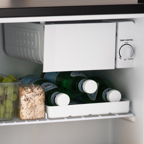 White mini fridge with ice box